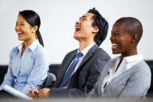 Business audience laughing