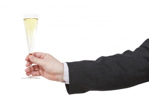 side view of champagne glass in male hand isolated on white background